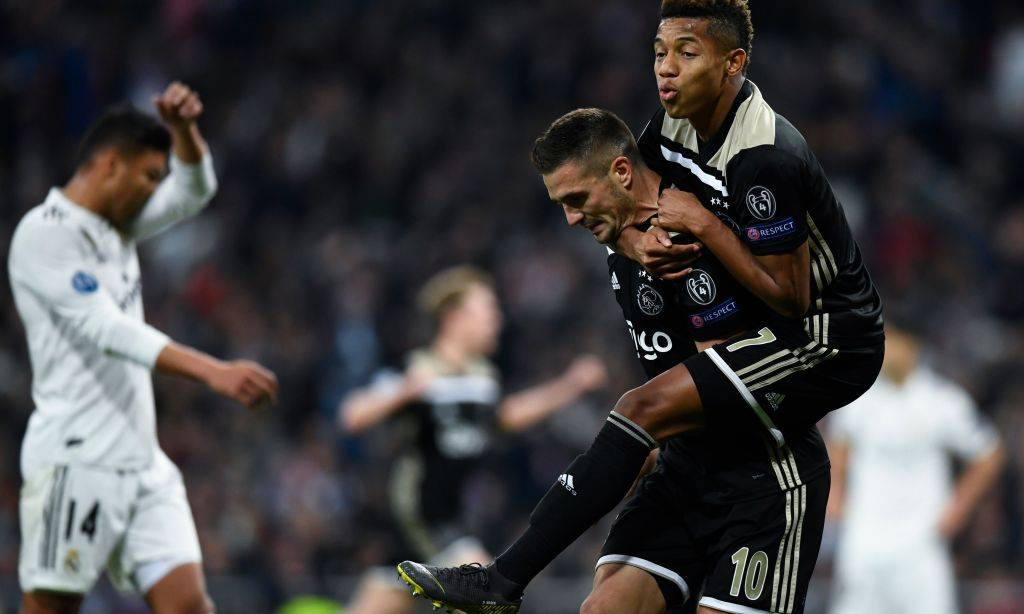 Ajax's Serbian forward Dusan Tadic celebrates with Ajax's Brazilian forward David Neres (R) after scoring his team's third goal during the UEFA Champions League round of 16 second leg football match between Real Madrid CF and Ajax at the Santiago Bernabeu stadium in Madrid on March 5, 2019. (Photo by GABRIEL BOUYS / AFP)GABRIEL BOUYS/AFP/Getty Images ORIG FILE ID: AFP_1E96FE